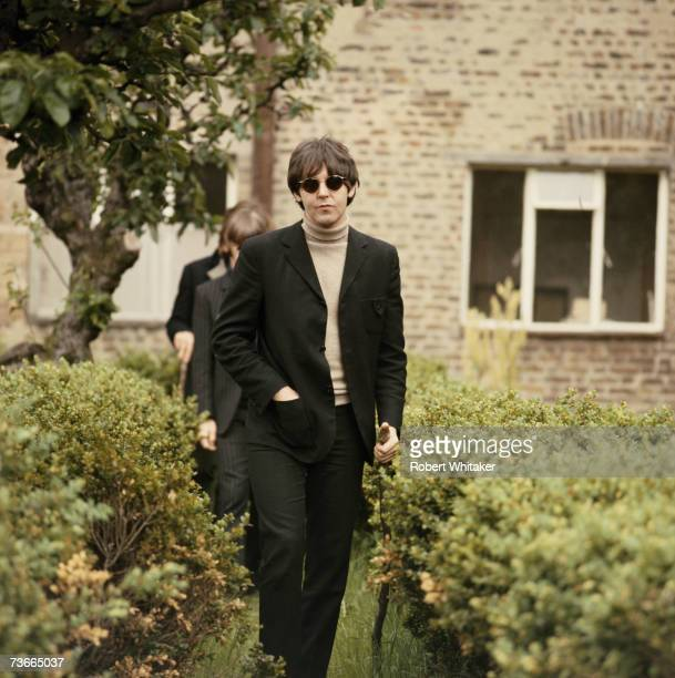 Paul McCartney of the Beatles in Chiswick House grounds London during the making of promotional films for the single 'Rain' and 'Paperback Writer'...