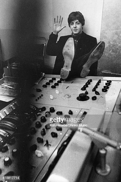 Paul McCartney of The Beatles puts his feet up on the mixing desk in the control room of Studio 2 at EMI Studios Abbey Road London during the...