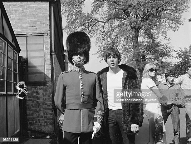 Paul McCartney of the Beatles with actor Victor Spinetti at Twickenham Studios London during a photoshoot to complete the cover of the Beatles' album...