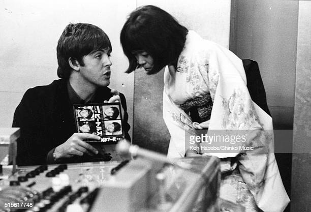 Paul McCartney of The Beatles with Japanese music journalist Rumi Hoshika at EMI Studios Abbey Road London during the recording session for 'It's...
