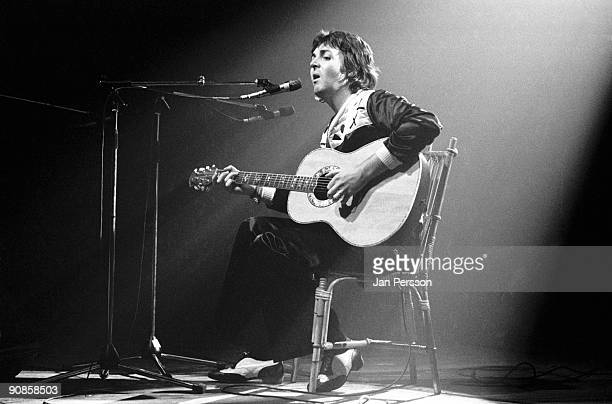 Paul McCartney of Wings performs on stage playing an Ovation acoustic guitar at Falkoner Theatre in Copenhagen on March 20th 1976 in Denmark