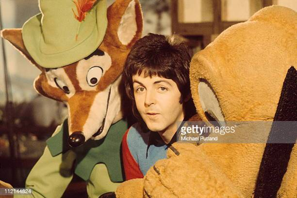 Paul McCartney of Wings posed with Disney characters in 1973