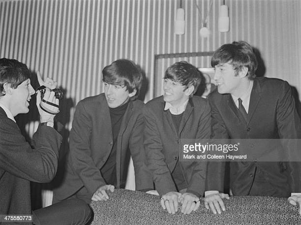 Paul McCartney photographs his fellow Beatles at the Gaumont Cinema Doncaster 10th December 1963 Left to right McCartney George Harrison Ringo Starr...