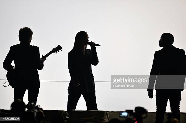 Paul McCartney Rihanna and Kanye West perform on the stage at the 57th Annual Grammy Awards in Los Angeles February 8 2015 AFP PHOTO / ROBYN BECK