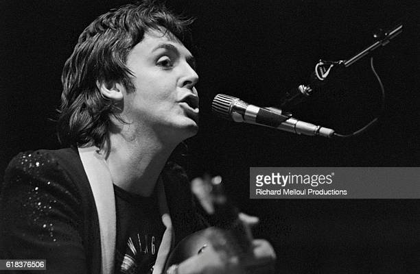 Paul McCartney singer and guitarist for his band Wings performs during a concert in Paris