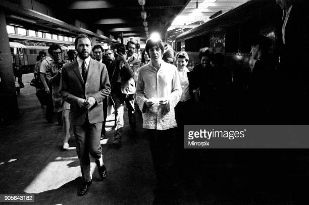 Paul McCartney walking along the platform to his awaiting train as The Beatles leave London Euston Station for Bangor in North Wales where they will...