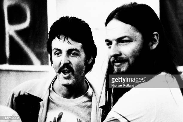 Paul McCartney with David Gilmour of Pink Floyd, portrait, backstage at Knebworth Music Festival, 1976.