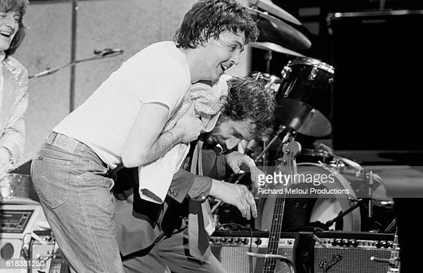 Paul McCartney wrestles Who guitarist Pete Townshend following a benefit concert at the Hammersmith Odeon in London for Cambodian refugees Led...