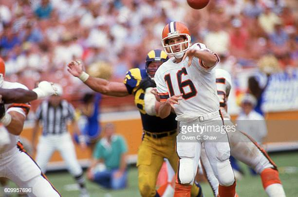 Paul McDonald of the Cleveland Browns circa 1984 passes against the Los Angeles Rams at Anaheim Stadium in Anaheim California