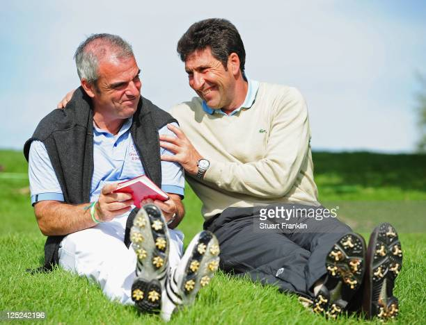 Paul McGinley, capatin of the Great Britian and Ireland team talks with Ryder Cup Captain Jose Maria Olazabal of Spain during the second days...