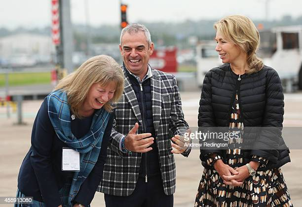 Paul McGinley Captain of the Europe team and wife Allison McGinley talk to Shona Robison Scotland's Minister for Sport as they wait for the arrival...