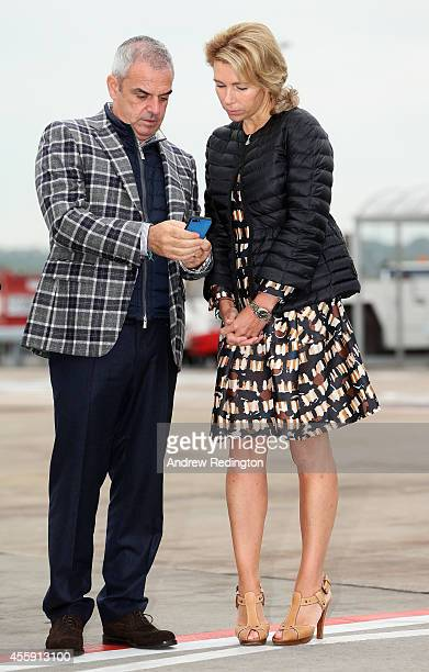 Paul McGinley Captain of the Europe team and wife Allison McGinley talk as they wait for the arrival of the United States team at Edinburgh Airport...