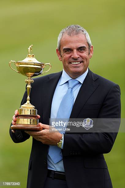 Paul McGinley European Ryder Cup Captain poses with the Ryder Cup during a photocall to announce The McGinley Foundation as the Fourth and final...