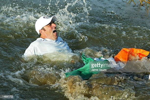 Paul McGinley of Europe is thrown into the lake after holing the winning putt during the final day singles of the 34th Ryder Cup matches between...