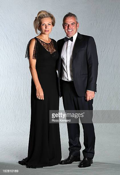Paul McGinley of Europe poses with his wife Ally for a portrait at the Ryder Cup host hotel prior to the start of the 39th Ryder Cup Gala on...