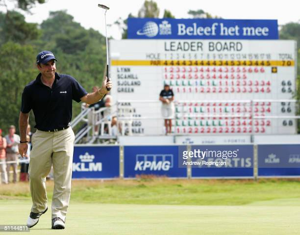 Paul McGinley of Ireland acknowledges the crowd after his eagle on the 18th hole during the first round of the KLM Open at Hilversum Golf Club on...