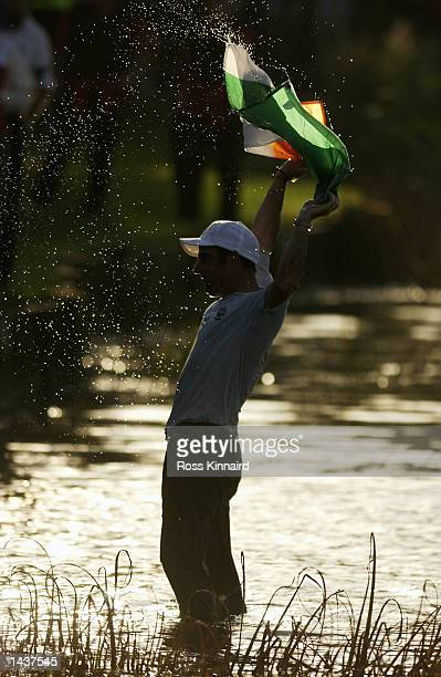 Paul McGinley of Ireland celebrates after being thrown in the lake on the 18th after Europe win the Ryder Cup during the singles matches on the final...