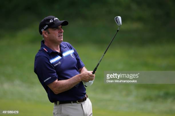 Paul McGinley of Ireland hits his second shot on the 1st hole during the final round of the Open de Espana held at PGA Catalunya Resort on May 18,...