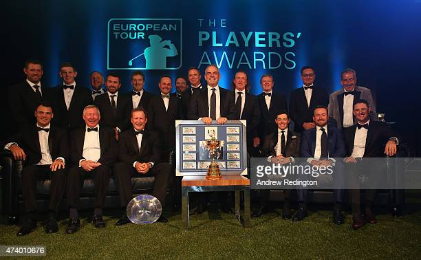 Paul McGinley of Ireland poses with his gift from the players during the European Tour Players' Awards ahead of the BMW PGA Championship at the...