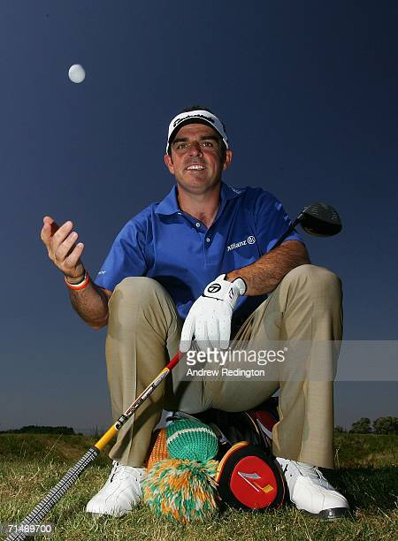 Paul McGinley of Ireland poses with the new Taylor Made TP Red golf ball during practice for The Open Championship at Royal Liverpool Golf Club on...