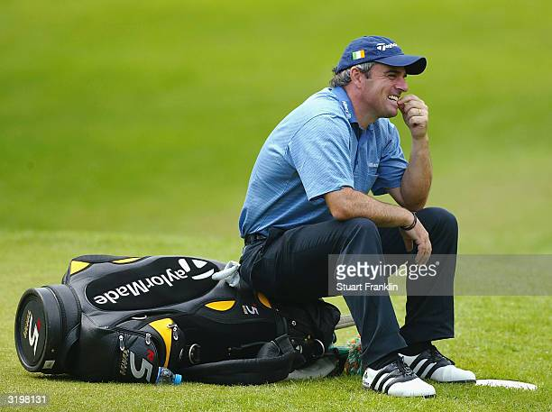 Paul McGinley of Ireland sits on his bag whilst waiting on the fifth hole during the second round at The Algarve Open de Portugal Golf at Le Meridien...