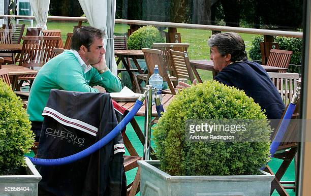 Paul McGinley of Ireland talks to psychologist Jos Vanstiphout during practice for the Nissan Irish Open at Carton House Golf Club on May 17 2005 in...