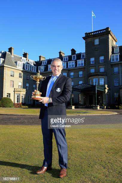 Paul McGinley of Ireland the 2014 European Ryder Cup Team Captain poses with the Ryder Cup outside the Gleneagles Hotel venue for the 2014 Ryder Cup...