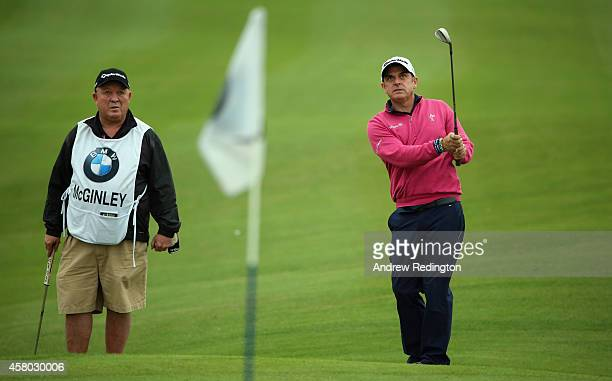 Paul McGinley of Ireland with caddie 'Edinburgh Jimmy' Rae during the Pro Am prior to the start of the BMW Masters at Lake Malaren Golf Club on...