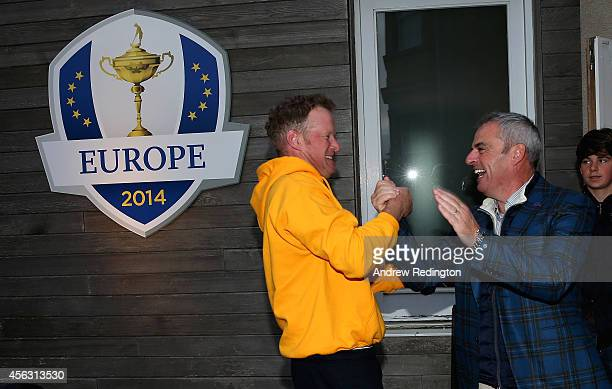 Paul McGinley the victorious European Ryder Cup team captain and Jamie Donaldson shake hands at The Gleneagles Hotel on September 29 2014 in...