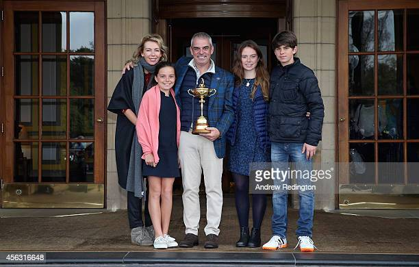 Paul McGinley the victorious European Ryder Cup team captain poses for a photograph with his wife Alison daughter Maia daughter Niamh and son Killian...