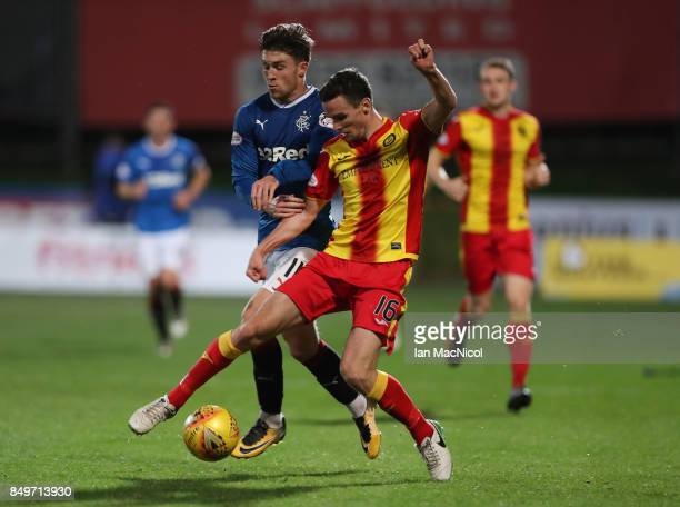 Paul McGinn of Partick Thistle vies with Josh Windass of Rangers during the Betfred League Cup Quarter Final at Firhill Stadium on September 19 2017...