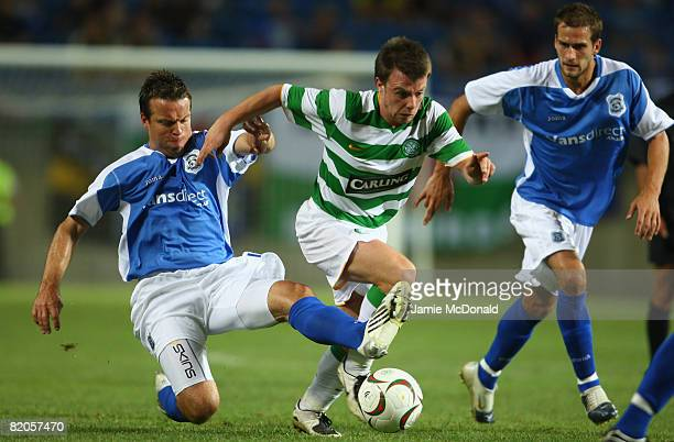 Paul McGowan of Celtic battles with Gavin Rae of Cardiff during the Algarve Challenge Cup match at the Estadio Algarve on July 24, 2008 in Faro,...