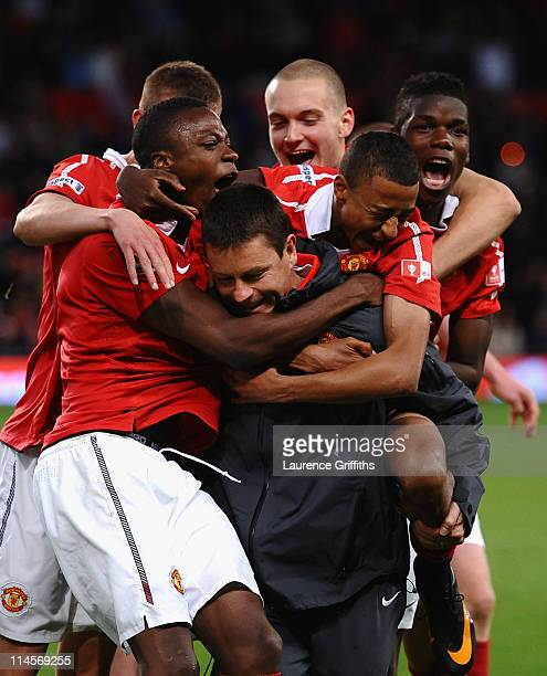 Paul McGuinness of Manchester United is mobbed by his players after victory in the FA Youth Cup Final 2nd Leg match between Manchester United and...