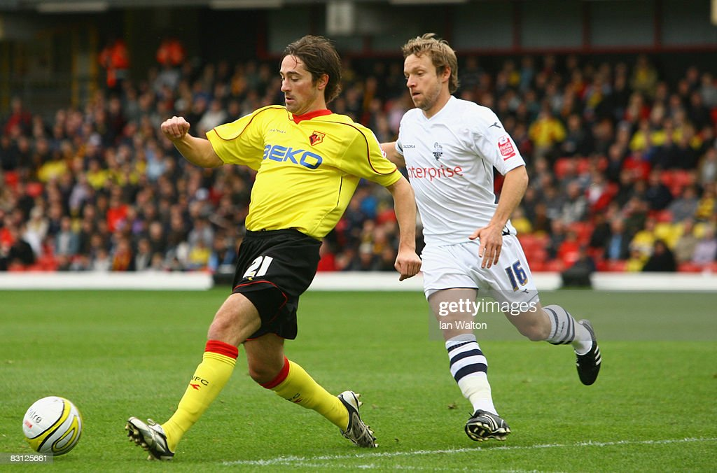 Paul McKenna of Preston tries to tackle Tommy Smith of Watford during the Coca-Cola Championship match between Watford and Preston North End at Vicarage Road on October 04, 2008 in Watford, England.