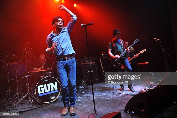 Paul McManus Dante Gizzi Johnny McGlynn and Derek Brown of Gun performs on stage at Shepherds Bush Empire on February 11 2012 in London United Kingdom