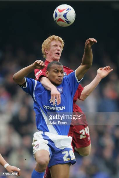 Paul McShane of Brighton challenges Danny Haynes of Ipswich during the CocaCola Championship match between Ipswich Town and Brighton Hove Albion at...