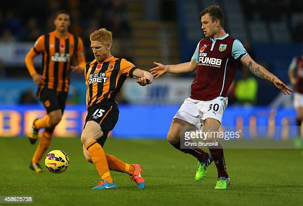 Paul McShane of Hull City is closed down by Ashley Barnes of Burnley during the Barclays Premier League match between Burnley and Hull City at Turf...