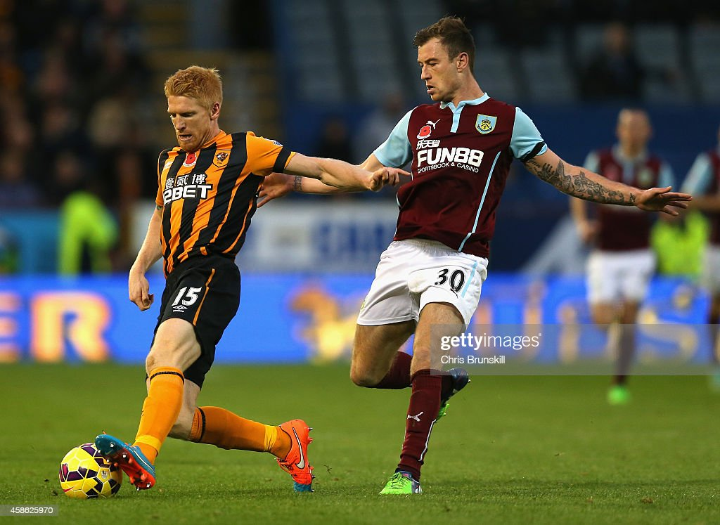 Paul McShane of Hull City is closed down by Ashley Barnes of Burnley during the Barclays Premier League match between Burnley and Hull City at Turf Moor on November 8, 2014 in Burnley, England.