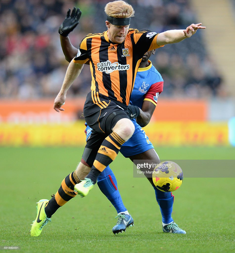 Paul McShane of Hull City tackled by Yannick Bolasie of Crystal Palace during the Barclays Premier League match between Hull City and Crystal Palace at KC Stadium on November 23, 2013 in Hull, England.