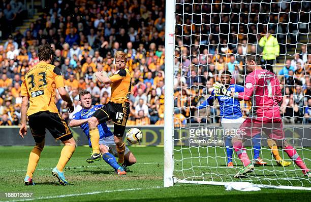 Paul McShane of Hull scores his team's second goal past goalkeeper David Marshall of Cardiff during the npower Championship match between Hull City...