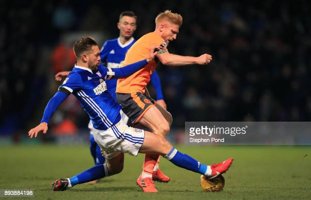 Paul McShane of Reading and Luke Chambers of Ipswich Town compete for the ball during the Sky Bet Championship match between Ipswich Town and Reading...