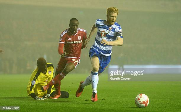 Paul McShane of Reading gets past Albert Adomah of Middlesbrough during the Sky Bet Championship match between Middlesbrough and Reading at the...