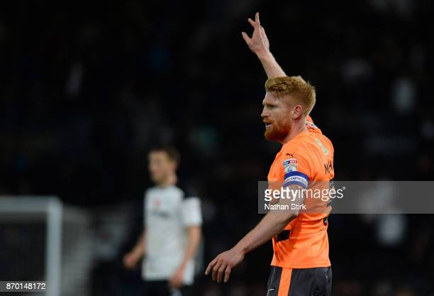 Paul McShane of Reading gives his team mates instructions during the Sky Bet Championship match between Derby County and Reading at iPro Stadium on...