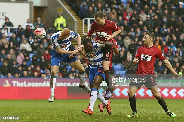 Paul McShane of Reading heads the ball to score his team's first goal during the Emirates FA Cup fifth round match between Reading and West Bromwich...