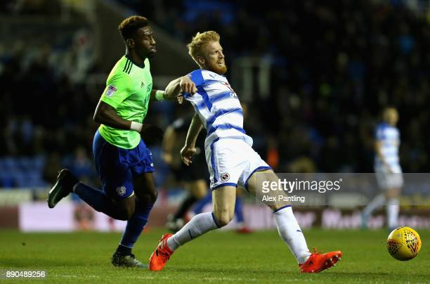 Paul McShane of Reading is closed down by Junior Hoilett or Cardiff during the Sky Bet Championship match between Reading and Cardiff City at...