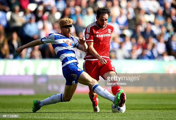 Paul McShane of Reading slides in to tackle Kike of Middlesbrough during the Sky Bet Championship match between Reading and Middlesbrough at Madejski...