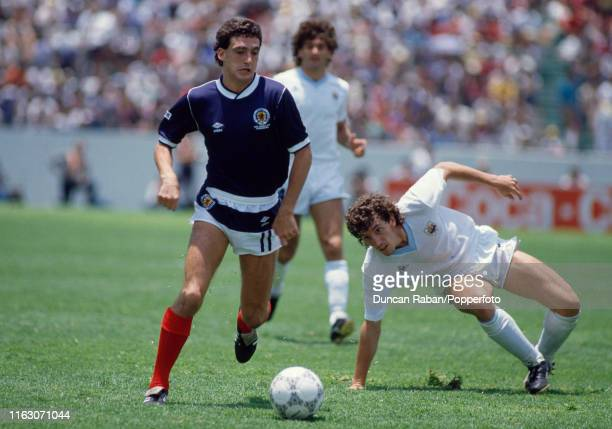Paul McStay of Scotland moves past a Uruguay defender during a FIFA World Cup Group E match at the Estadio Neza 86 on June 13 1986 in Nezahualcoyotl...
