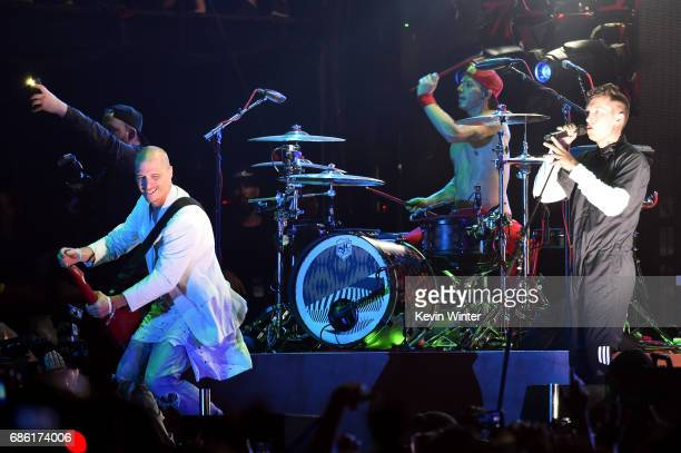 Paul Meany of Mutemath performs with Josh Dun and Tyler Joseph of Twenty One Pilots at the Hangout Stage during 2017 Hangout Music Festival on May 20...