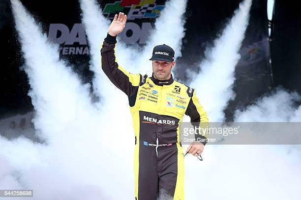 Paul Menard, driver of the Duracell/Menards Chevrolet, is introduced prior to the NASCAR Sprint Cup Series Coke Zero 400 Powered By Coca-Cola at...