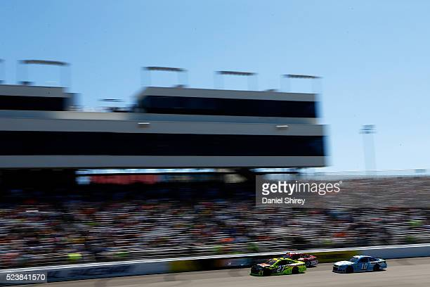 Paul Menard, driver of the Duracell/Menards Chevrolet, Kyle Larson, driver of the Target Chevrolet, and Danica Patrick, driver of the Nature's Bakery...